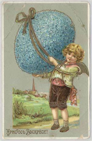 Ангел с пасхальным яйцом из синих цветков